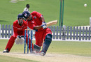 Bermuda's Jason Anderson hits a six during his unbeaten 106 against Hong Kong at the ICC WCL Division 2 in Dubai on 9th April 2011