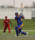 AJ Burger slugs a boundary through mid-wicktet for Namibia XI against Hong Kong XI in a WCL2 warm-up game at the Emirates Sevens ground on 5th April 2011