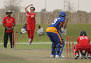 Maxwell Tucker bowling for a Hong Kong XI versus Namibia XI in a WCL2 warm-up game