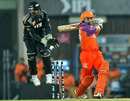 Brad Hodge pulls in front of square leg as Robin Uthappa looks on