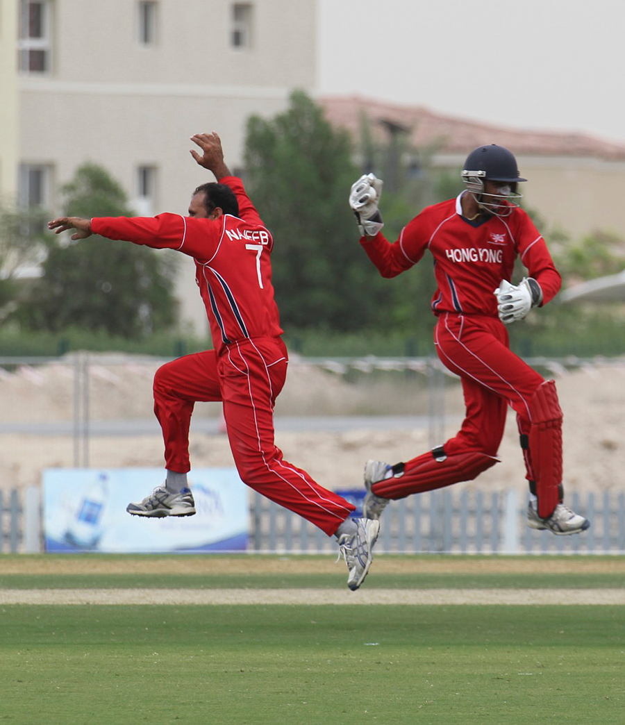 Najeeb Amar and Waqas Barkat celebrate a Namibian wicket in Dubai