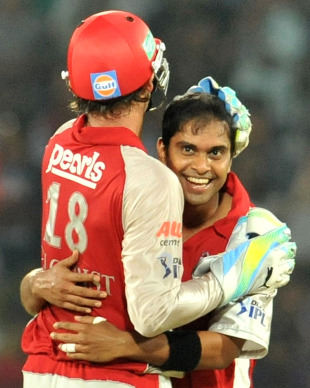 Paul Valthaty gets a hug from Adam Gilchrist after dismissing Amit Mishra