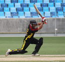 PNG's Chris Kent drives during his innings of 59 against Hong Kong in an ICC WCL2 match at the DSC Stadium in Dubai on 12th April 2011