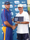 Louis Klazinga receives his Man of the Match Award from former New Zealand international Dayle Hadlee after taking 5-50 against Hong Kong at the ICC WCL2 in Dubai on 14th April 2011
