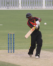 Vani Morea hits a boundary during his unbeaten 74 against Hong Kong in the 3rd/4th Play-off match at the ICC WCL2 in Dubai on 15th April 2011