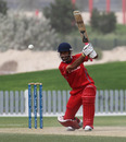 Hussain Butt drives the ball against PNG in the 3rd/4th Play-off match at the ICC WCL2 in Dubai on 15th April 2011