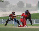Najeeb Amar sweeps against PNG in the 3rd/4th Play-off match at the ICC WCL2 in Dubai on 15th April 2011