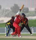 Max Tucker drives against PNG in the 3rd/4th Play-off match at the ICC WCL2 in Dubai on 15th April 2011