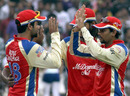 The Bangalore fielders celebrate the exit of Brad Haddin