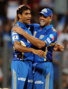 Munaf Patel and Andrew Symonds celebrate the wicket of M Vijay