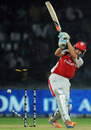 Adam Gilchrist's middle stump goes for a walk