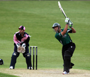 Vikram Solanki threads one through the off side during his fifty