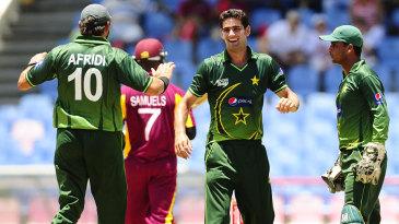 Hammad Azam celebrates his first international wicket