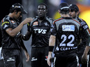 Jerome Taylor is congratulated after getting Michael Hussey