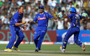 Shane Warne and his team-mates celebrate the wicket of Rohit Sharma