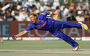 Shane Warne attempts a diving catch
