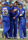 Shane Warne congratulates Ashok Menaria after the dismissal of Ambati Rayudu