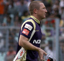 Bard Haddin walks back after scoring 18