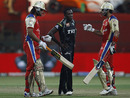 Jerome Taylor looks on as Saurabh Tiwary and Virat Kohli take a break from plundering runs, Royal Challengers Bangalore v Pune Warriors, IPL 2011, Bangalore, April 29, 2011