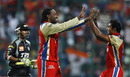 Chris Gayle and Abhimanyu Mithun celebrate the fall of Mithun Manhas, Royal Challengers Bangalore v Pune Warriors, IPL 2011, Bangalore, April 29, 2011