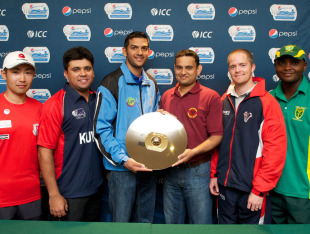 The captains of the six participating teams with the World Cricket League Division 7 trophy ahead of the tournament in Botswana