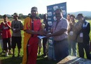 Madhu Menon, Chairman of Lobatse Cricket Club, presents Germany's Rana-Javed Iqbal a trophy, Japan v Germany, ICC World Cricket League Division Seven, Gaborone, Botswana, May 1, 2011