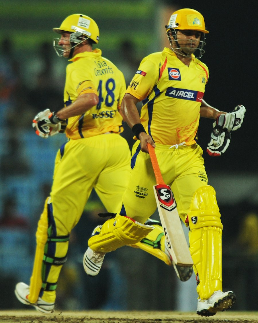 Michael Hussey and Suresh Raina run during their 60-run partnership