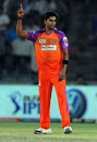 R Vinay Kumar raises his finger after dismissing Yogesh Nagar