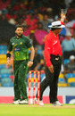 Shahid Afridi watches as Asoka de Silva calls for the covers, West Indies v Pakistan, 4th ODI, Barbados, May 2, 2011