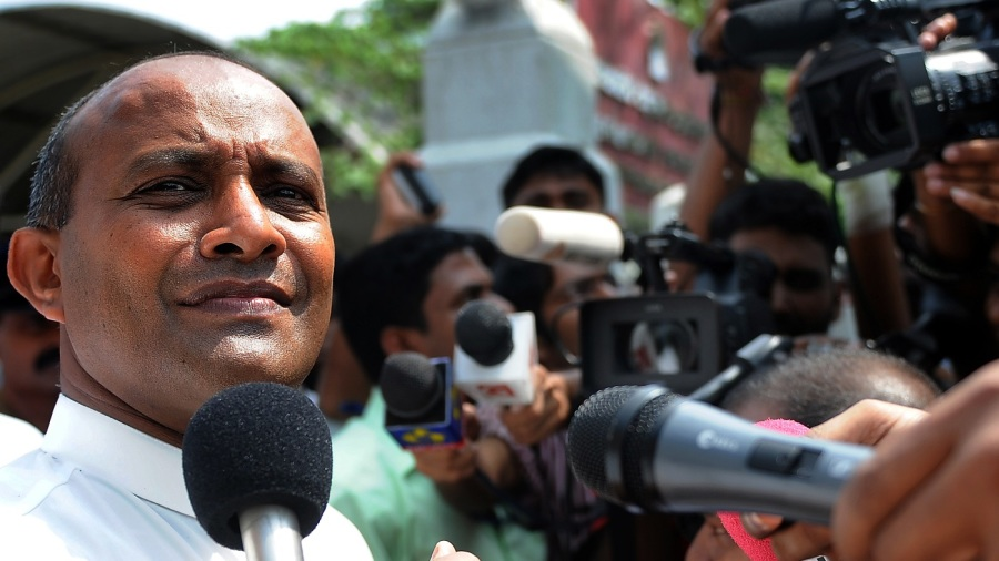 Hashan Tillakaratne speaks to reporters in Colombo