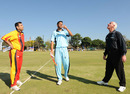 Botswana captain Akrum Chand tosses, while German captain Asif Khan and umpire Rudi Koertzen look on, Botswana v Germany, World Cricket League Division 7, Gaborone, May 4, 2011