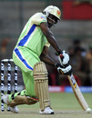 Chris Gayle is about to loft down the ground, Bangalore v Kochi, IPL 2011, Bangalore, May 8, 2011