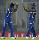 Munaf Patel and Andrew Symonds celebrate a wicket