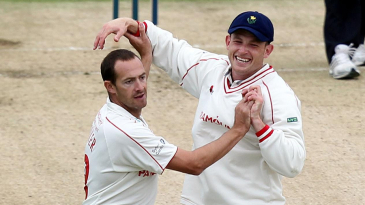 Dean Cosker celebrates one of three wickets against Kent