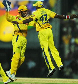 MS Dhoni and Dwayne Bravo celebrate after the latter took a stunner, Chennai Super Kings v Delhi Daredevils, IPL 2011, Chennai, May 12, 2011