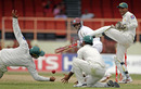 Shivnarine Chanderpaul survives as an edge eludes the slips