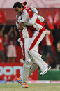 Shalabh Srivastava hugs Adam Gilchrist after dismissing David Warner, Kings XI Punjab v Delhi Daredevils, IPL 2011, Dharamsala, May 15, 2011