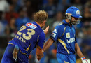 Shane Warne shakes hands with Rohit Sharma on his way out