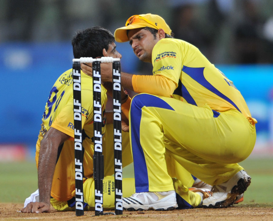 A concerned Suresh Raina checks R Ashwin after he took a blow to his head