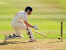 Michael Powell can't stop the ball rolling back into his stumps on 99