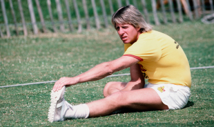Jeff Thomson stretches his calf muscles, June 1, 1983