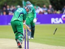 Kevin O'Brien watches his off stump disappear