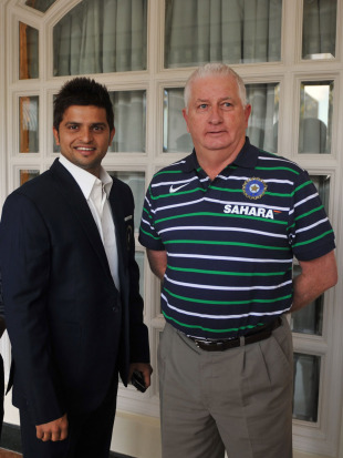 Suresh Raina and Duncan Fletcher prior to India's departure, Mumbai, May 31, 2011