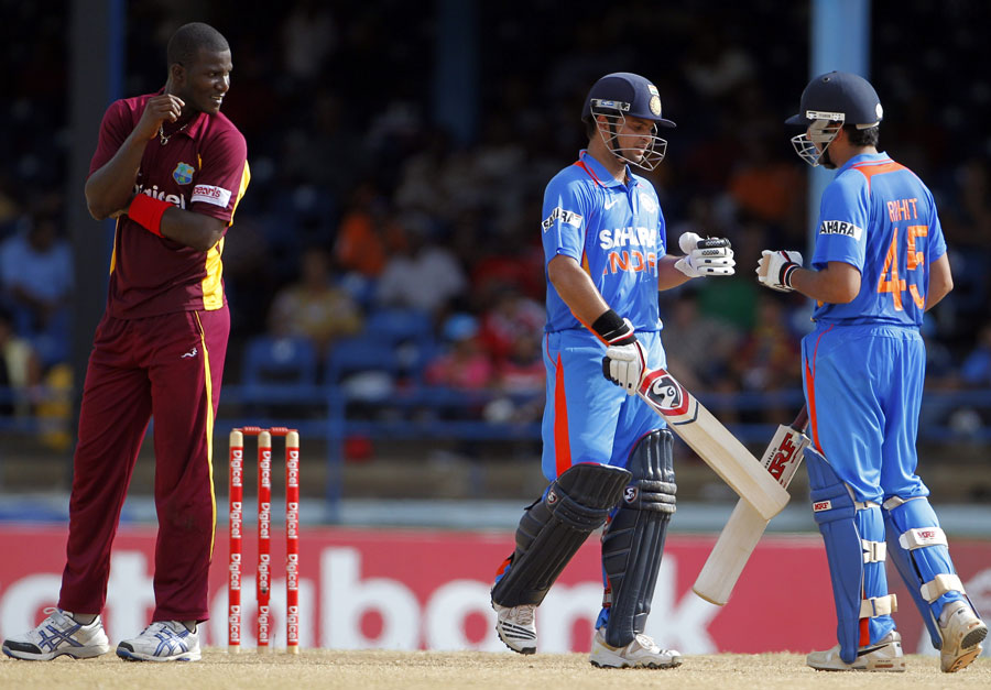 Suresh Raina and Rohit Sharma took the game away from Darren Sammy's men