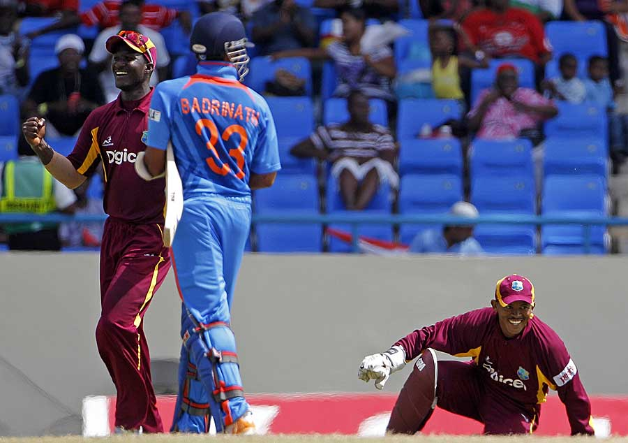 S Badrinath was caught behind for 12