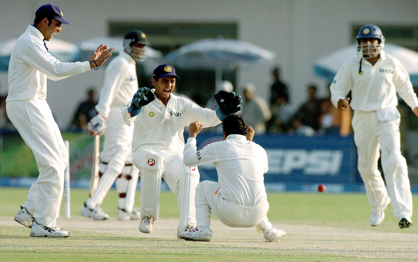 Sting in the tail: Sachin Tendulkar gets Moin Khan with the last ball of day three in Multan, 2004