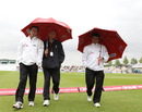 The umpires spent plenty of time under umbrellas, England v Sri Lanka, 3rd Test, Rose Bowl, June 17, 2011