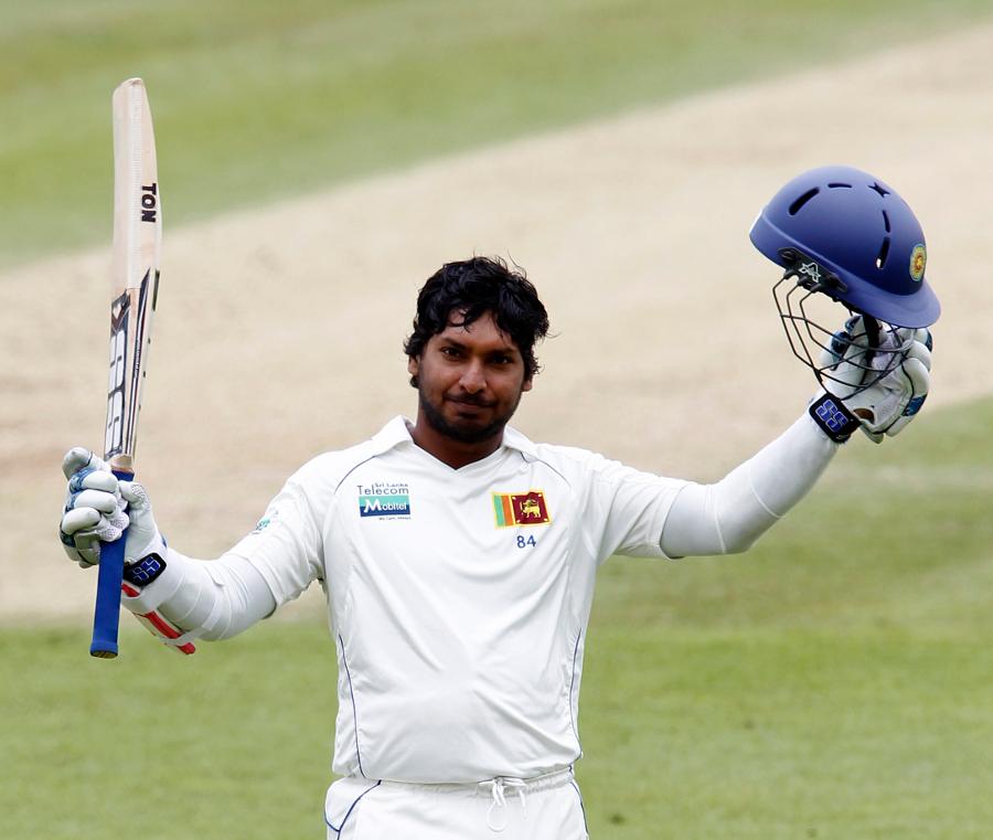 Kumar Sangakkara acknowledges applause after reaching his first Test hundred in England | Photo | England v Sri Lanka 2011 | ESPNcricinfo.com