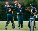 Australia get together after Shelley Nitschke snags a wicket, Australia Women v India Women, NatWest Women's T20 Quadrangular Series, Billericay, June 23, 2011