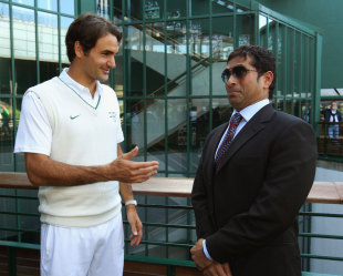 Sachin Tendulkar speaks to Roger Federer at Wimbledon, London, June 25, 2011
